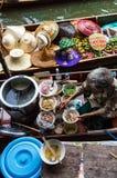 Food vendor at Damnoen Saduak Floating Market, Thailand. Royalty Free Stock Photography