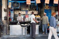 Food Vendor in Delhi, India. Street scene in Delhi, India in fron of food shop royalty free stock photo