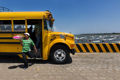 Food vendor leaving a bus in the Ferry Terminal in the town of San Jorge in the shores of the Lake Nicaragua, Nicaragua Stock Photos