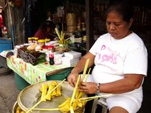 Food vendor packs a bunch of local food delicacy called suman Royalty Free Stock Images