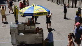 Food Vendor And Tourists Stock Photo