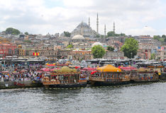 Food Vendors,Fish Boats and people at Eminonu by the sea in Istanbul,Turkey Stock Photo