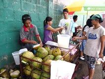 Food vendors sell fresh buko Stock Images