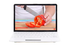Food video blog concept - video blogger making food on laptop sc Royalty Free Stock Photos