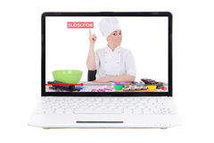 Food video blog concept - woman making food and pointing at subs. Cribe button on laptop screen isolated on white background royalty free stock image