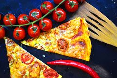 Food wallpaper with italian pizza portion. On a baking tray Stock Photography