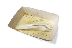 Food waste on paper plates with plastic knives and forks isolate Royalty Free Stock Photography
