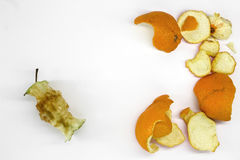 Food waste. On a white background are: Apple core, skin from the orange Stock Images