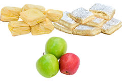 Food on white. Fruits and pastry on white background Royalty Free Stock Photography