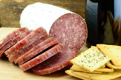 Food and Wine. Wine Cheese and Meat on Wood Stock Images