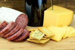 Food and Wine. Wine Cheese and Meat on Wood Stock Photos