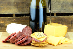 Food Wine and Knife. Wine Cheese and Meat on Wood Stock Photos