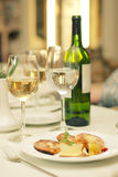 Food wine tasting on restaurant table. Bottle of food wine and two glasses on restaurant table. Tasting white wine Stock Image