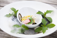 Food on wood. Food And dry ice smoke Stock Photo