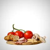 Food on wooden board. On white background Stock Photo