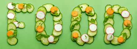 Food word made of raw vegetables Stock Images