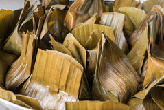 Food wrapped in banana leaves in steam pot, Traditional Thai style. Closeup food wrapped in banana leaves in steam pot, Traditional Thai style Stock Photography