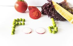 Food writing with green peas and red radish on the isolated background with bamboo knife stock photography
