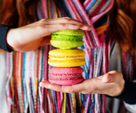 Young woman holding the french pastry macaron Royalty Free Stock Image