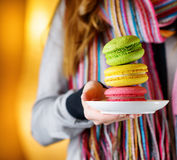 Young woman holding the french pastry macaron Stock Images