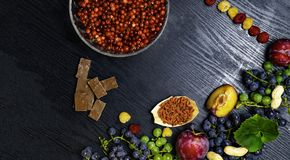 Brain boosting health food background border with fruits, nuts,berry. Foods high in vitamin C, vitamins, minerals, antioxidants an stock photo