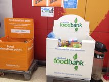 Foodbank donation point in the UK. A donation point for a foodbank in a superstore. This is where shoppers can donate some of their purchased foods to go to Royalty Free Stock Photography