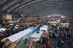 The Foodfestival from the East mezzanine. Amsterdam, the Netherlands - November 29, 2015: The busy Europe Complex (Europahal) viewed from the East mezzanine at Stock Photos