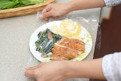 Foods covered with cling film. Delicious foods covered with cling film stock images