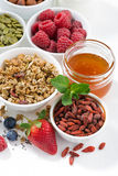 Foods for healthy nutrition and fresh berries on white table Royalty Free Stock Images