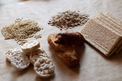 Foods high in carbohydrate. Healthy eating, diet concept. Bread, rice cakes, brown rice, oats. Oats and rice in a bowl. Rice cakes and bread in background royalty free stock photography