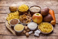Foods high in carbohydrate on rustic wooden background.  royalty free stock images
