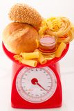 Carbohydrate. Foods high in carbohydrate on a scales royalty free stock photos