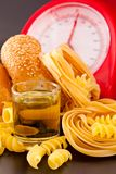 Carbohydrate. Foods high in carbohydrate on a scales stock photography