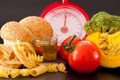 Carbohydrate. Foods high in carbohydrate on a scales stock images