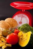 Carbohydrate. Foods high in carbohydrate on a scales royalty free stock images
