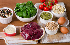 Foods high in Iron, including eggs, nuts, spinach, beans, seafoo stock photo