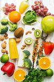 Foods high in vitamin C. Fruits, vegetables, nuts, greens, citrus fruits. Top view, flat lay. The concept of healthy nutrition and royalty free stock images