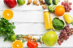Foods high in vitamin C. Fruits, vegetables, nuts, greens, citrus fruits. Top view, flat lay. The concept of healthy nutrition and stock photography