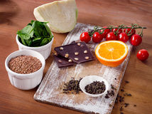 Foods high in vitamin P on a wooden table. Stock Images
