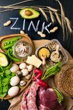 Foods High in Zinc as octopus, beef, buckwheat, yellow cheese, spinach, avokado,pea, mushrooms, bean, radishes, eggs. Top view Royalty Free Stock Photos