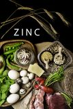 Foods High in Zinc as octopus, beef, buckwheat, yellow cheese, spinach, avokado,pea, mushrooms, bean, radishes, eggs. Top view. Foods Highest in Zinc as octopus royalty free stock image