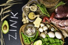 Foods High in Zinc as octopus, beef, buckwheat, yellow cheese, spinach, avokado,pea, mushrooms, bean, radishes, eggs. Top view Stock Photography