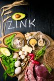 Foods High in Zinc as octopus, beef, buckwheat, yellow cheese, spinach, avokado,pea, mushrooms, bean, radishes, eggs. Top view Stock Images