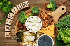 Foods rich in calcium. Such as sardines, bean, dried figs, almonds, cottage cheese, hazelnuts, parsley leaves, blue poppy seed, broccoli, italian cabbage Royalty Free Stock Photo