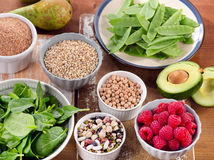 Foods rich in Fiber on wooden table. Royalty Free Stock Images