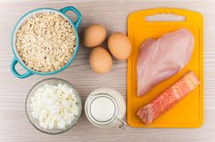 Foods rich in protein and carbohydrates on table Stock Photos