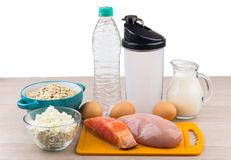 Foods rich in protein and carbohydrates. Water and a shaker isolated on white background stock image