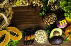 Foods rich in vitamin E such as wheat germ oil or olive oil, dried apricots, pine nuts, papaya,hazelnuts, almonds, pumpkin,rosehip stock photo