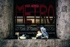 Foodstuff next to a metro sign in Paris - homeless theme stock image