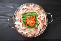 Foodstuffs of Pork and Kimchi hot pot. On a dining table royalty free stock photo
